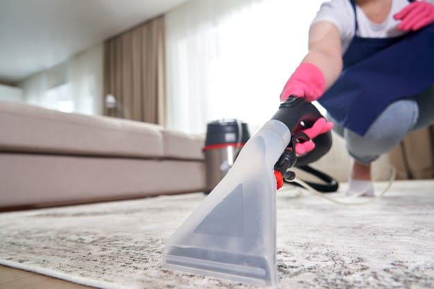 Vacuuming water from carpet